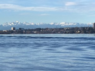 The Olympic Mountains create a stunning backdrop for Seattle and Husky Stadium